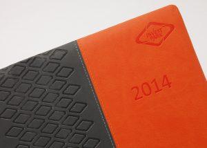 Markenwerbung schwarz-orange Notizbuch-Myrix
